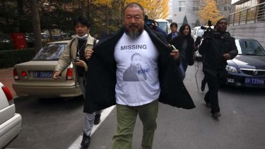 Unhappy ... Ai Weiwei makes his way to the tax office.