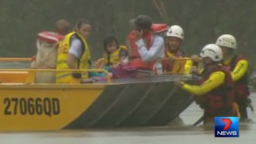 Family of five rescued from a flooded road near Cooktown.