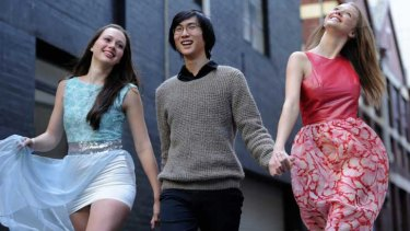 Fifteen-year-old fashion designer Andy Truong with models Beata Laurenson and Morgana Powell wearing his creations.