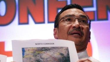 Hishamuddin Hussein shows maps during a press conference near Kuala Lumpur.