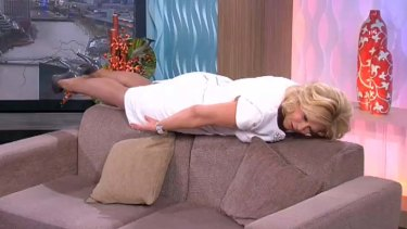 """Kerri-Anne Kennerley performs some """"planking"""" on her morning show."""