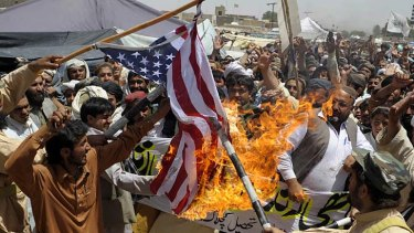Pakistani Islamists burn a US flag against the killing of Osama bin Laden during a protest in the outskirts of Quetta.