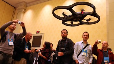 The Parrot Air Drone quadricopter flies overhead during a press event at the Consumer Electronics Show.