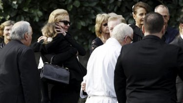Family gathers to mourn: Nicole Kidman (far left) at her father's funeral.