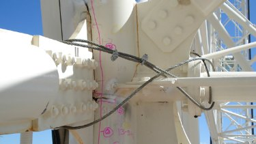 Photographs of the observation wheel show large cracks in the steel structure.