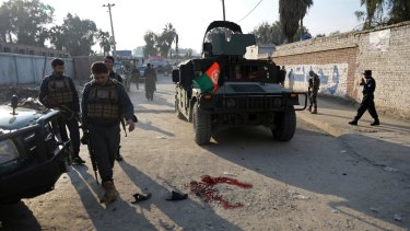 Afghan security police arrive at the scene of a suicide attack in Nangarhar province east of Kabul, Afghanistan.