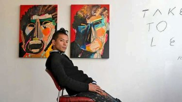 Artist Shohei Takasaki with his work at the Backwoods Gallery.