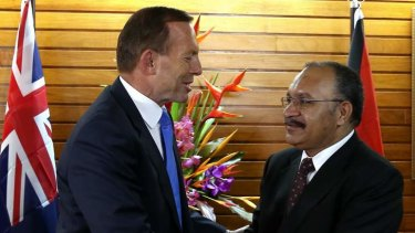 Prime Minister Tony Abbott and PNG Prime Minister Peter O'Neill at Parliament House in Port Moresby.