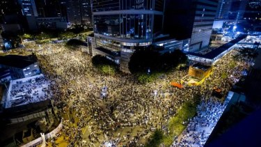 Rally point: Thousands of pro-democracy protesters gather outside Hong Kong's government headquarters, vowing to maintain an increasingly tense civil disobedience campaign.