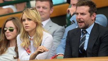 Toothpick for your thoughts?: Actor Bradley Cooper and his girlfriend British model Suki Waterhouse in the royal box at the men's final in Wimbledon.