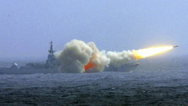 Fire power: A Chinese warship fires a missile during a training exercise in the South China Sea.