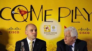 Mark Arbib (L) speaks next to Football Federation Australian Chairman Frank Lowy last year, ahead of Australia's 2022 World Cup bid.