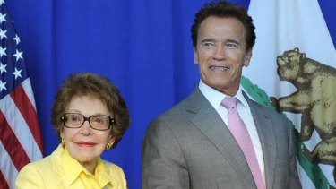 Economic strife ... Arnold Schwarzenegger, pictured here with Nancy Reagan on Wednesday,  is forcing state workers in California to take leave.