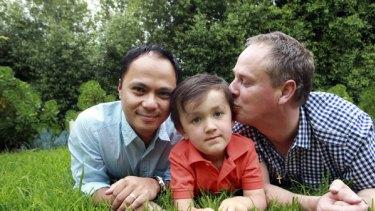 Jason and Adrian Tuazon-McCheyne and their four-year-old son, Ruben.
