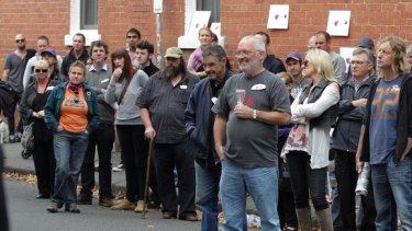 The auction of the Rose Hotel drew a crowd of onlookers. The pub sold for $2.65 million.