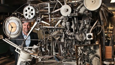Peter Denham with Wes Standfield's mousetrap-making machine.