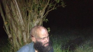 Seven years on the run ... Malcom Naden is taken away after being captured by police.
