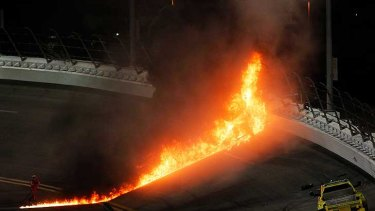 A jet dryer bursts into flames after being hit by Juan Pablo Montoya.