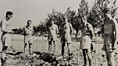 Ashes to ashes ... air force chaplain Fred McKay at a funeral for pilots in Italy in 1945.