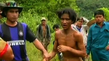 A screen shot from Vietnamese television shows Ho Van Lang, who reportedly spent 40 of his 41 years living wild in the jungle.