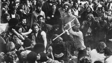 A fan is beaten by Hells Angels at the Rolling Stones' free concert at Altamont Speedway. The rock press called it the end of innocence.