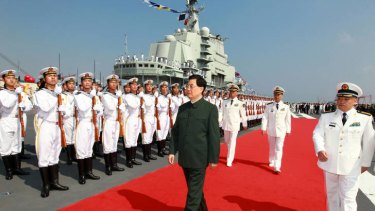 Naval power ... the Chinese President, Hu Jintao, inspects the guard of honour at the launch of the aircraft carrier Liaoning.
