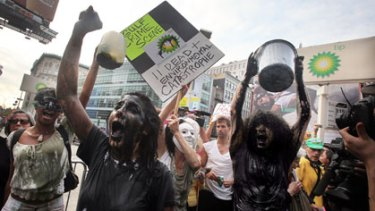 Protesters outside a BP petrol station in Manhattan.