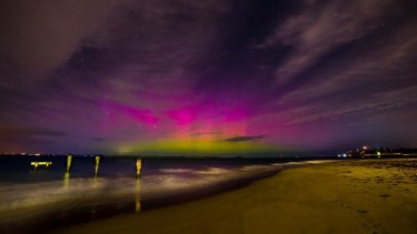 The aurora australis seen from behind the Queenscliff ferry terminal.