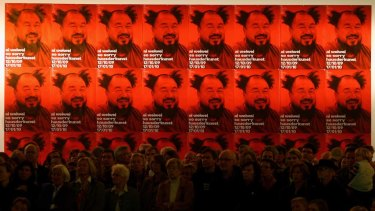Visitors listen to Ai Weiwei, one of China's most controversial  artists, during the  'So Sorry' exhibition  in Munich in 2009.