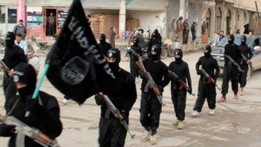 ISIL fighters in Raaqa, Syria.