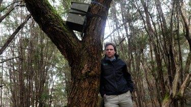 Biologist Dan Harley with a possum nest box at Yellingbo.
