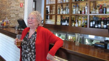 Merle Thorton at the bar named in her honour at the Regatta Hotel.