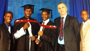 Peter Roebuck at the graduation ceremony for Tatenda Dennis Chadya and Tapiwa Diamond Chadya in 2010.