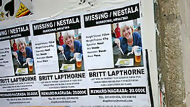 Posters offering a 20,000 euro ($A35,600) reward for  information leading to the discovery of Melbourne backpacker Britt Lapthorne plaster a building  in Dubrovnik, Croatia, where she went missing on September 17.