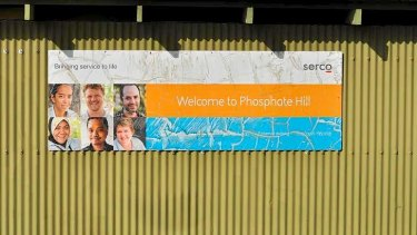 A welcome sign by management company Serco adorns the side of a building at Phosphate Hill Detention Centre on Christmas Island.