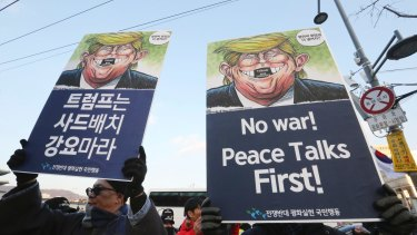 South Korean protesters hold up cartoons depicting US President Donald Trump during a rally against US Defence Secretary Jim Mattis' visit.