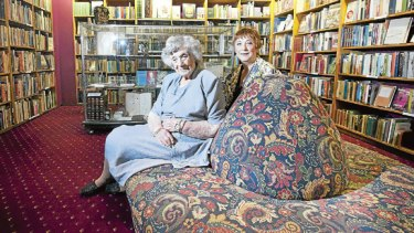 Muriel Craddock, 97, with daughter Kay in their family book store beneath Assembly Hall, in Collins Street.