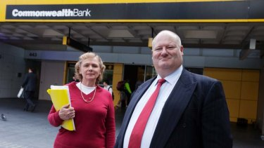 Merilyn Swan and Jeff Morris outside a Commonwealth Bank branch.