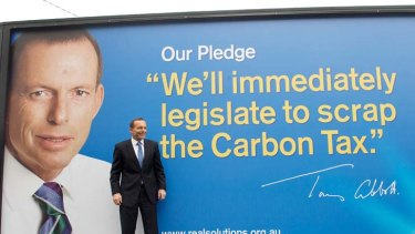 Taking the message to the people … the Opposition Leader, Tony Abbott, with a mobile billboard. Mr Abbott has said the next election will be a referendum on the carbon tax.