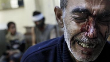 Nightmare of the Syrian people: a man mourns the death of his eight-year-old daughter in Aleppo in October 2012.