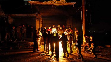 Under attack ... Syrian children gather around a bakery in the Shaar neighborhood of Aleppo.