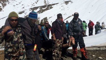 Saved: The Nepalese army helps survivors of the snowstorm.