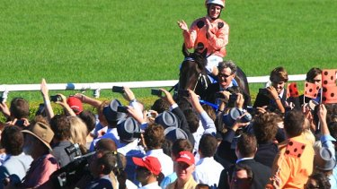 Been there, done that: Jockey Luke Nolen joins in the adulation of the crowd after Black Caviar won the 2011 running of the T.J. Smith Stakes at Randwick.