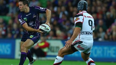Cooper Cronk looks for the pass.