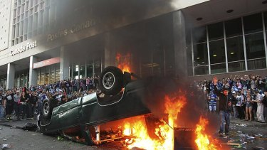 Not a good look ... Rioting in central Vancouver after an ice hockey game in June.