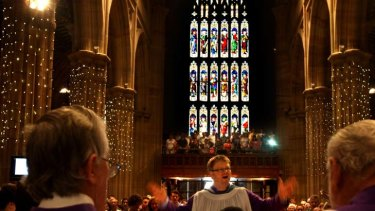Devoted rise in dark to worship God's light