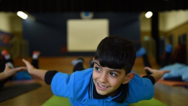 Yoga helps the children calm their minds and strengthen their bodies.