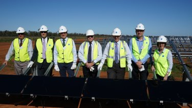 AGL's first installers: (L-R) Ray Donald, Bogan Shire Mayor; Ivor Frischknecht, ARENA, CEO; Kevin Humphries, Minister for Western NSW; Brian Stanley, First Solar Senior Vice President; Mark Coulton, Federal MP for Parkes; Scott Thomas, AGL executive; Leslie Williams MP, NSW Parliamentary Secretary for Renewable Energy.
