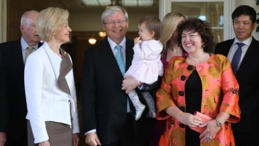 Prime Minister Kevin Rudd holding his granddaughter Joesphine with, left, the Governor-General Quentin Bryce and his wife Therese Rein after being sworn in as PM again.