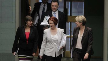 Prime Minister Julia Gillard enters the chamber for question time, with Labor colleagues Nicola Roxon and Tanya Plibersek.